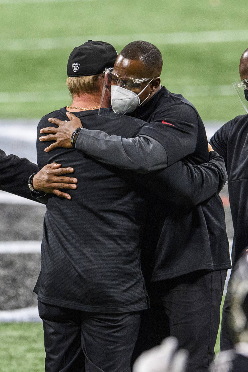 Atlanta Falcons interim head coach Raheem Morris and Las Vegas Raiders head coach Jon Gruden em ...