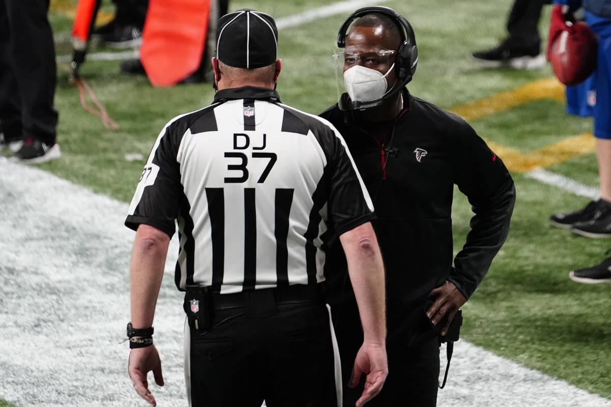Atlanta Falcons interim head coach Raheem Morris speaks to an official during the second half o ...