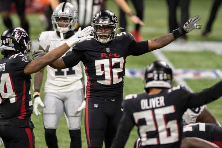 Atlanta Falcons cornerback Darqueze Dennard (34), Atlanta Falcons defensive end Charles Harris ...