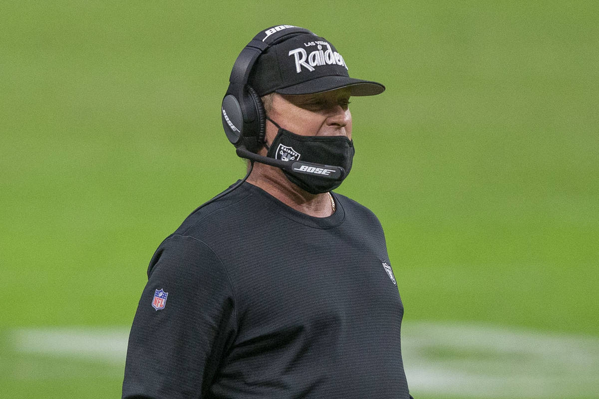 Las Vegas Raiders head coach Jon Gruden coaches from the sideline during the second quarter of ...