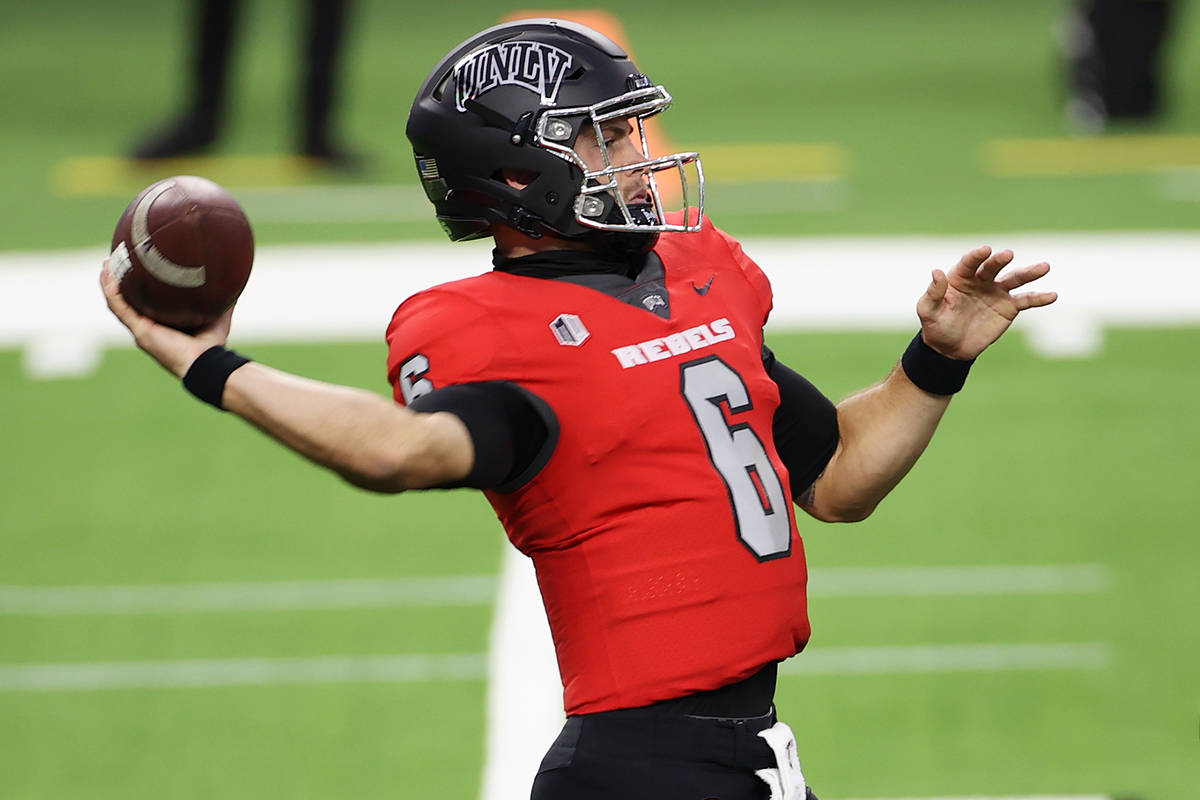 UNLV Rebels quarterback Max Gilliam (6) gets ready to throw a pass as offensive lineman Matt Br ...