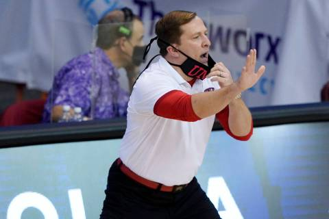 UNLV head coach T.J. Otzelberger directs his team in the first half of an NCAA college basketba ...