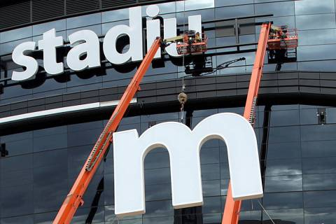 The last letter in the signage for the Raiders Allegiant Stadium logo is installed, in Las Vega ...