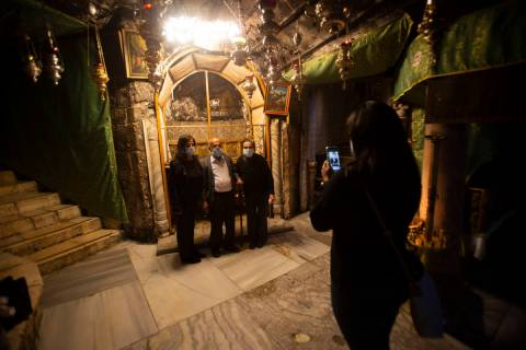 Christian take photos inside the Grotto of the Church of the Nativity, traditionally believed t ...