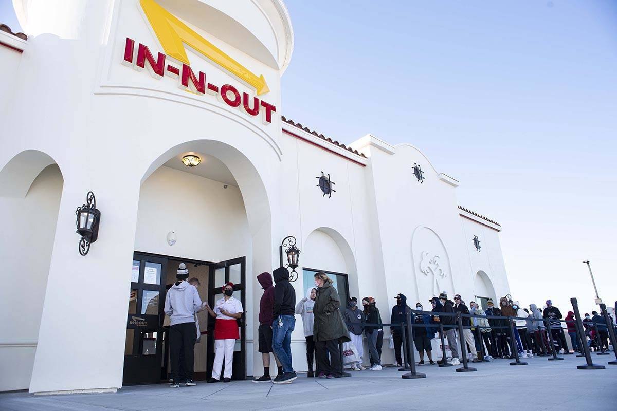 Customers begin to enter the new In-N-Out Burger restaurant Friday morning, Nov. 20, 2020, in n ...