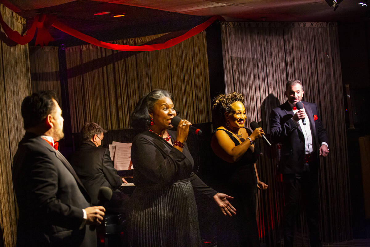 Singers, from left, Randal Keith, Amanda King, Michelle Johnson and Sam Holder perform along wi ...