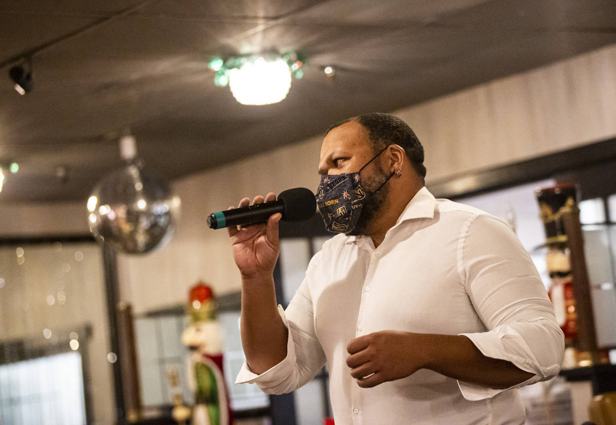 """Carnell Johnson, also known as Golden Pipes, sings during rehearsal for """"A Vegas Room Chri ..."""