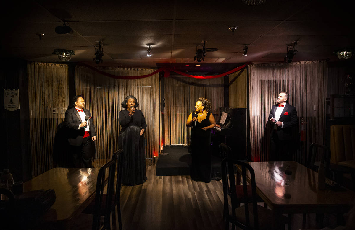 Singers, from left, Randal Keith, Amanda King, Michelle Johnson and Sam Holder perform during r ...