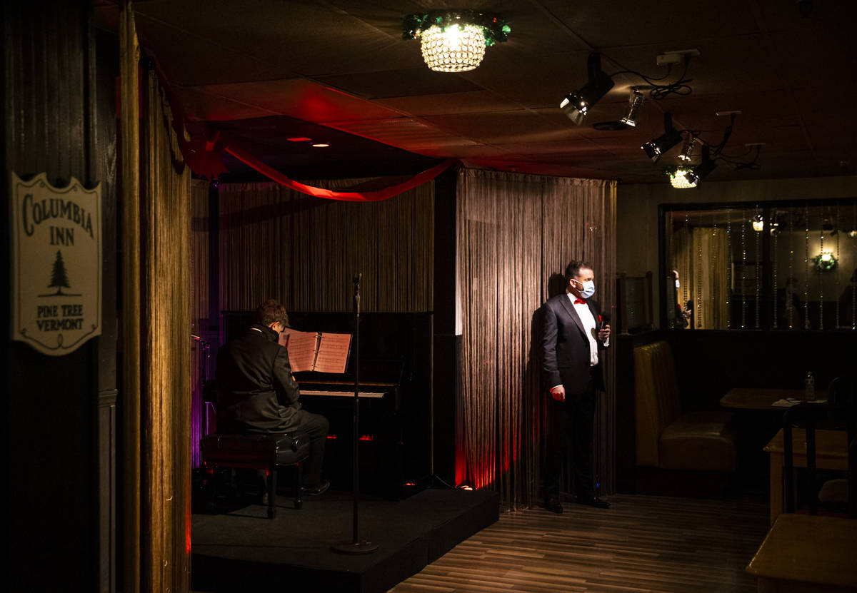 """Sam Holder, right, prepares to perform during rehearsal for """"A Vegas Room Christmas"""" ..."""