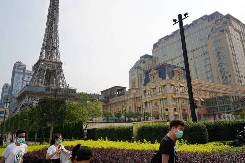 People walk along the sidewalk near the Parisian Macao on April 10, 2020. (Inside Asian Gaming)