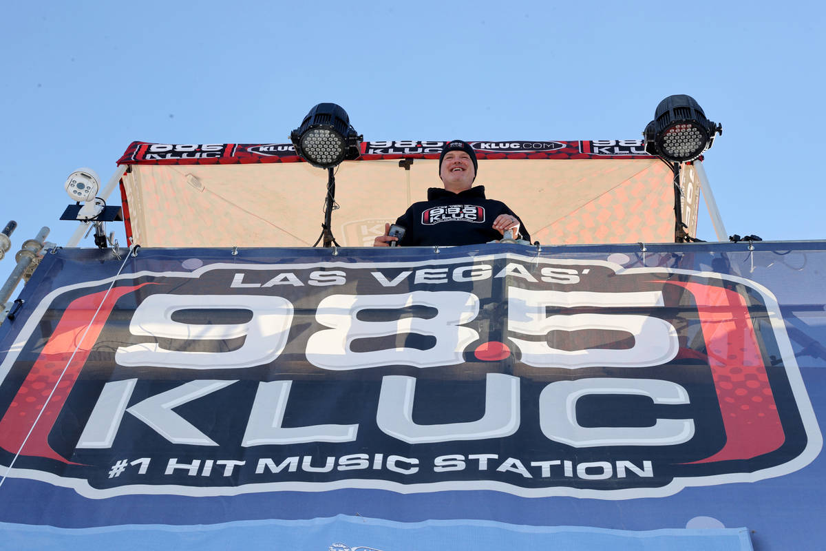 Chet Buchanan of KLUC-FM talks to volunteers atop a 30-foot scaffolding during his toy drive in ...