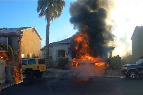Firefighters respond to a fire at at 2712 Rosarito St. on Tuesday, Dec. 1, 2020. (Las Vegas Fir ...