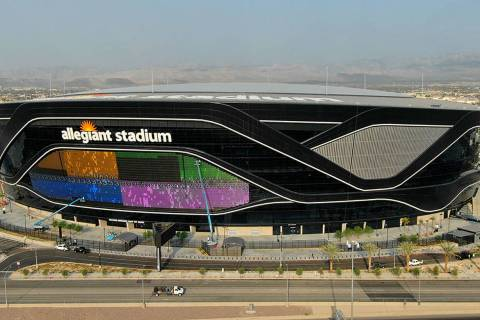 The massive 27,600 square foot video board lights up with color on the Interstate 15 facing por ...