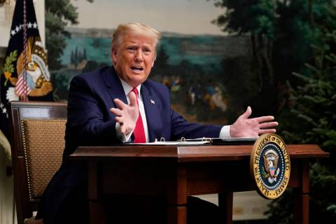 President Donald Trump speaks with reporters after participating in a video teleconference call ...