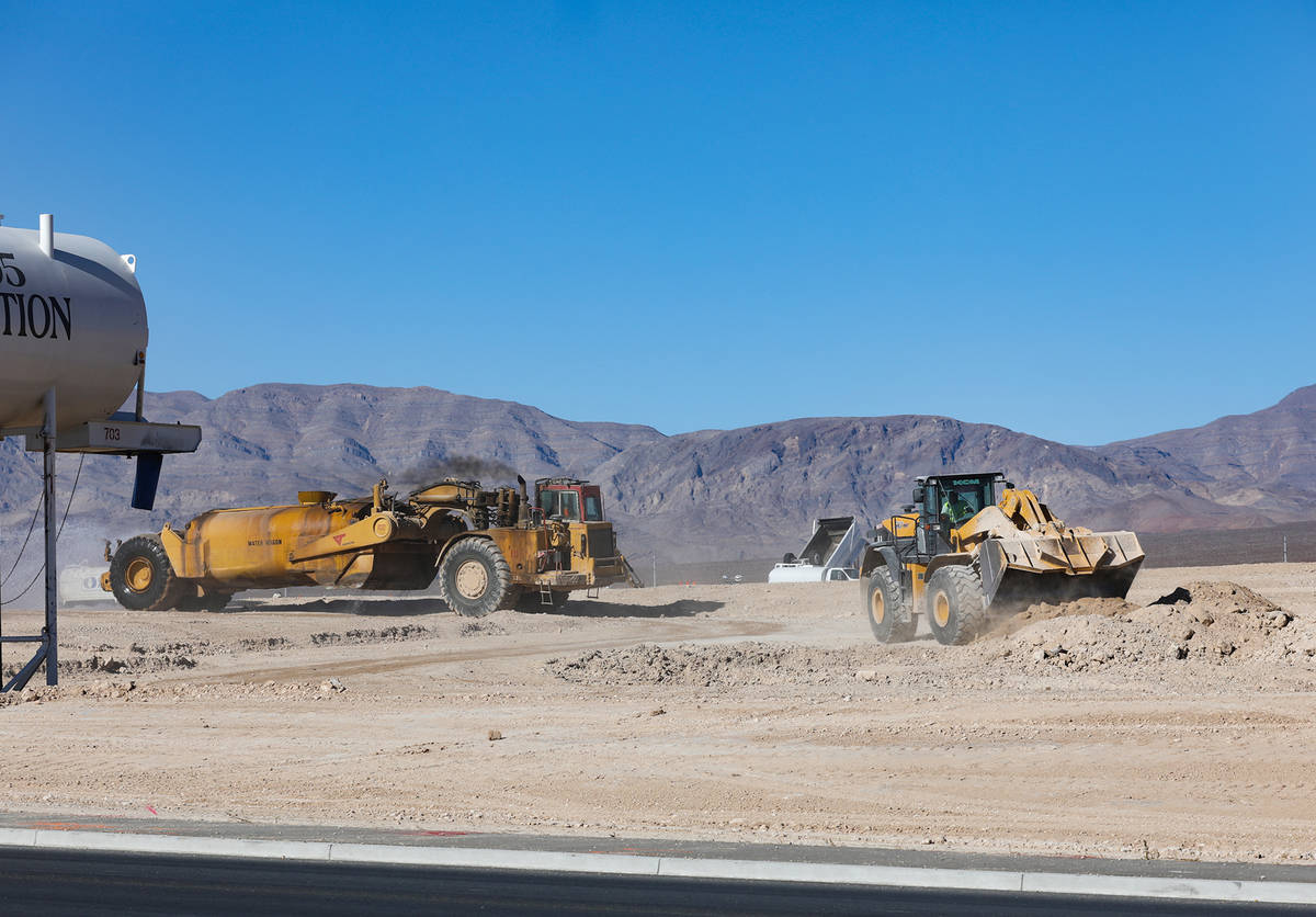 Construction on the future site of an Amazon facility across from the Amazon LAS7 Fulfillment C ...