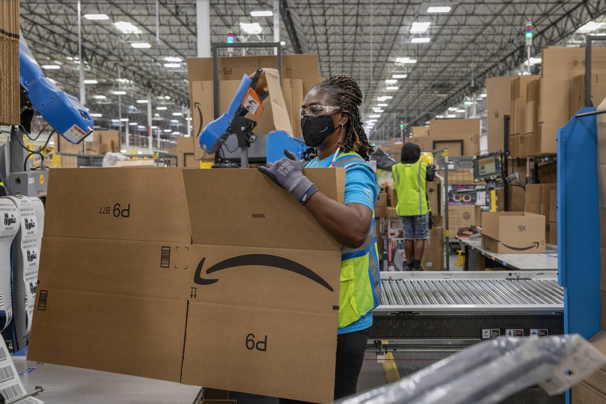 Amazon associate Lola Wickett packages products at AmazonÕs warehouse in North Las Vegas o ...