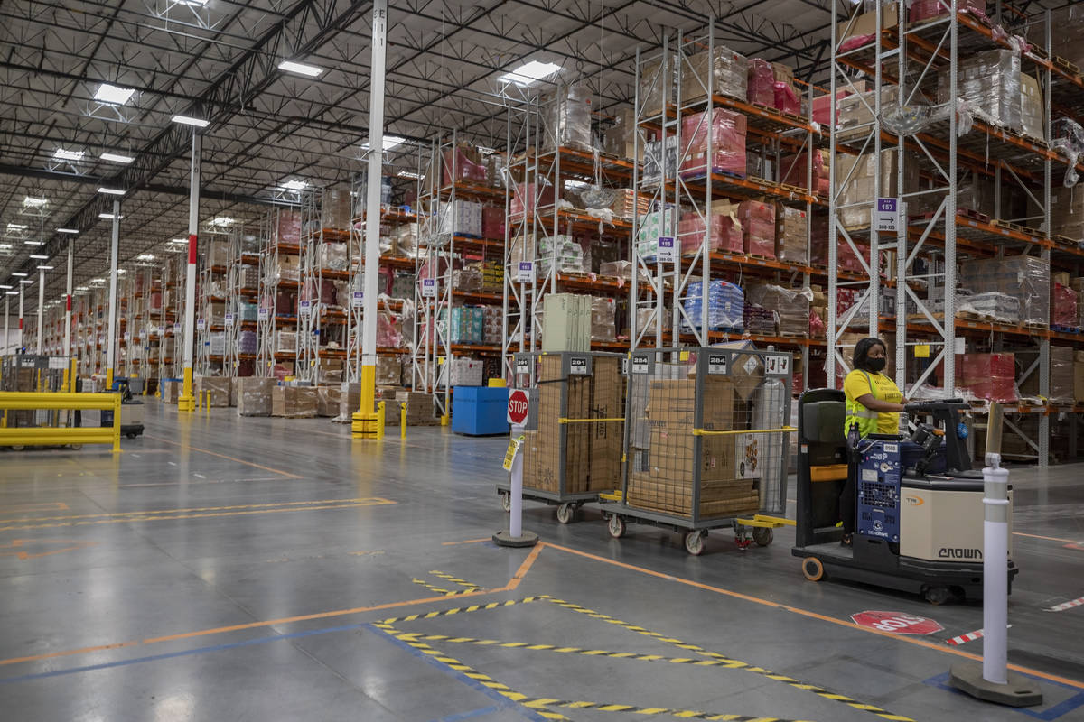 Production occurs at an Amazon warehouse in North Las Vegas on Thursday, July 30, 2020. (Elizab ...