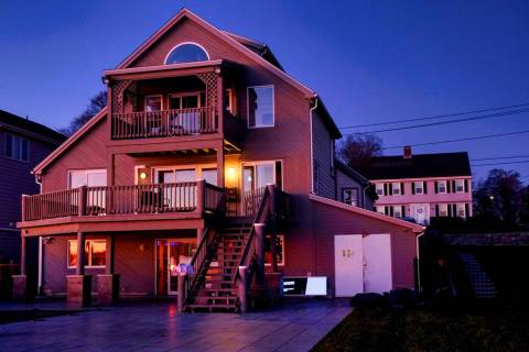 The early morning sun lights up the home at 500 Pequot Ave, along the Thames River, pictured on ...