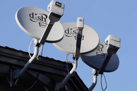 FILE - In this Feb. 23, 2011, file photo, Dish Network satellite dishes are shown at an apartme ...
