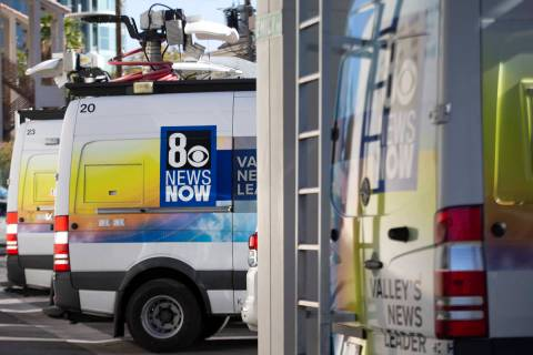 KLAS-TV, Channel 8 news trucks are lined up in the broadcast station's parking lot on Wednesday ...