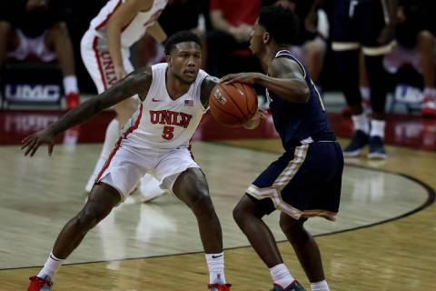 UNLV Rebels guard David Jenkins Jr. (5) pressures Montana State Bobcats guard Xavier Bishop (1 ...