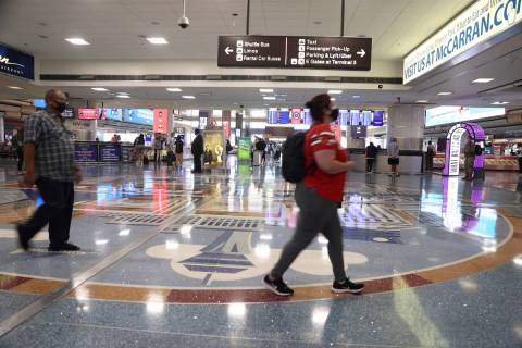 People leave baggage claim in Terminal 1 at McCarran International Airport in Las Vegas, Monday ...