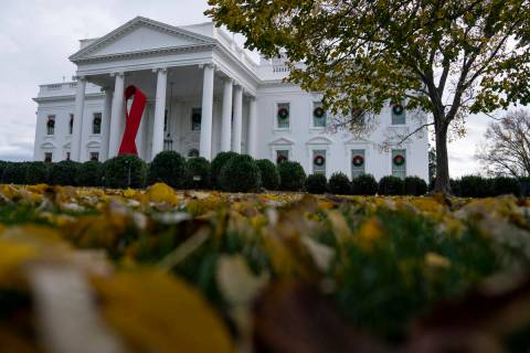 A ribbon hangs on the White House for World AIDS Day 2020, Tuesday, Dec. 1, 2020, in Washington ...