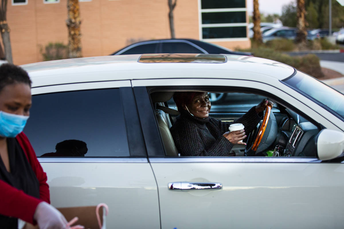 Ronny Flowers, of Las Vegas, drives by after getting a warm cup of hot chocolate during a chari ...