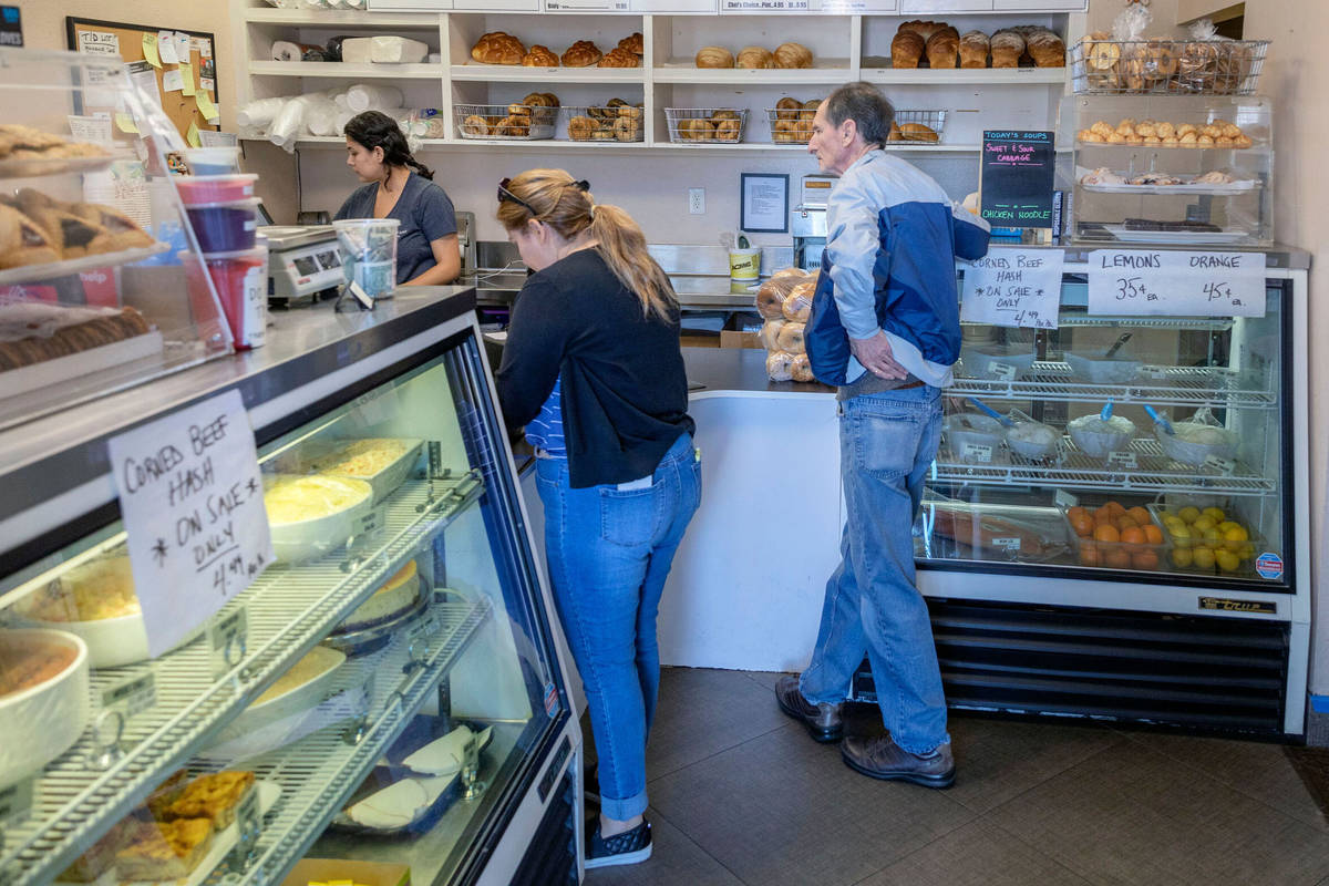 In this April 3, 2020, file photo, customers of Weiss Deli and Bakery wait to place a takeout o ...