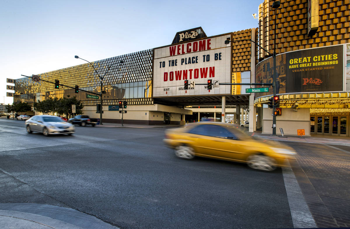 Cars stream past the current Greyhound bus terminal building downtown which the Plaza Hotel and ...