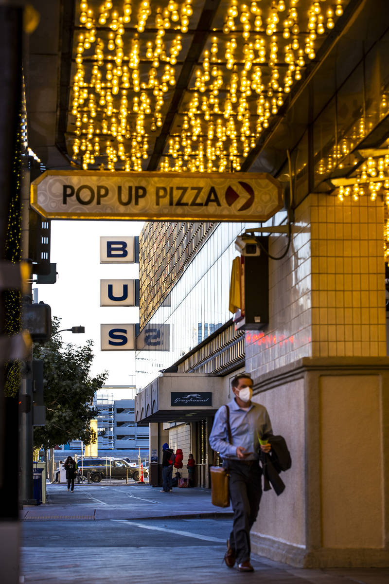A pedestrian walks along as the Plaza Hotel and Casino announces it will redevelop a building t ...