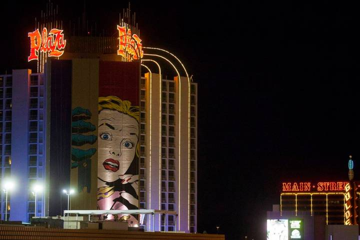 A mural by contemporary street artist D*face is shown in progress on the side of the Plaza hote ...
