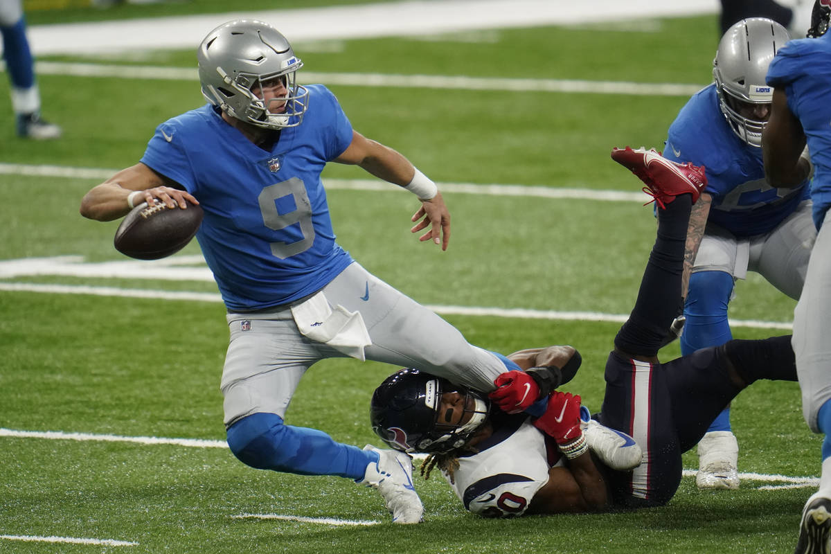 Houston Texans strong safety Justin Reid (20) sacks Detroit Lions quarterback Matthew Stafford ...