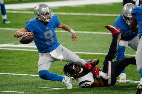 Houston Texans strong safety Justin Reid (20) sacks Detroit Lions quarterback Matthew Stafford ...