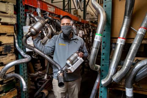 Chad Sims with the Supreme Automotive Warehouse holds one of the catalytic converters he has in ...