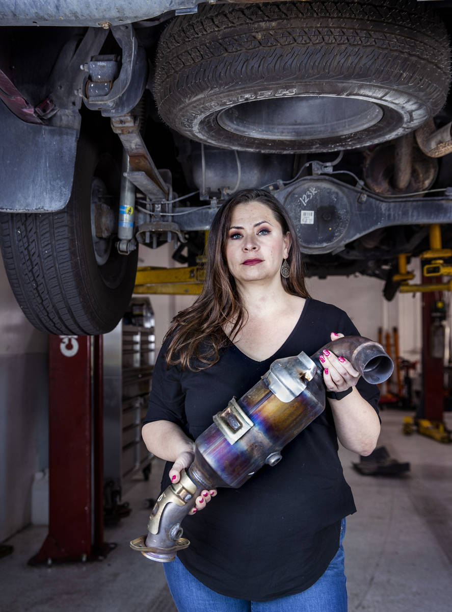 Danielle Vila, co-owner of Red Rock Repair, holds a recently removed catalytic converter at the ...