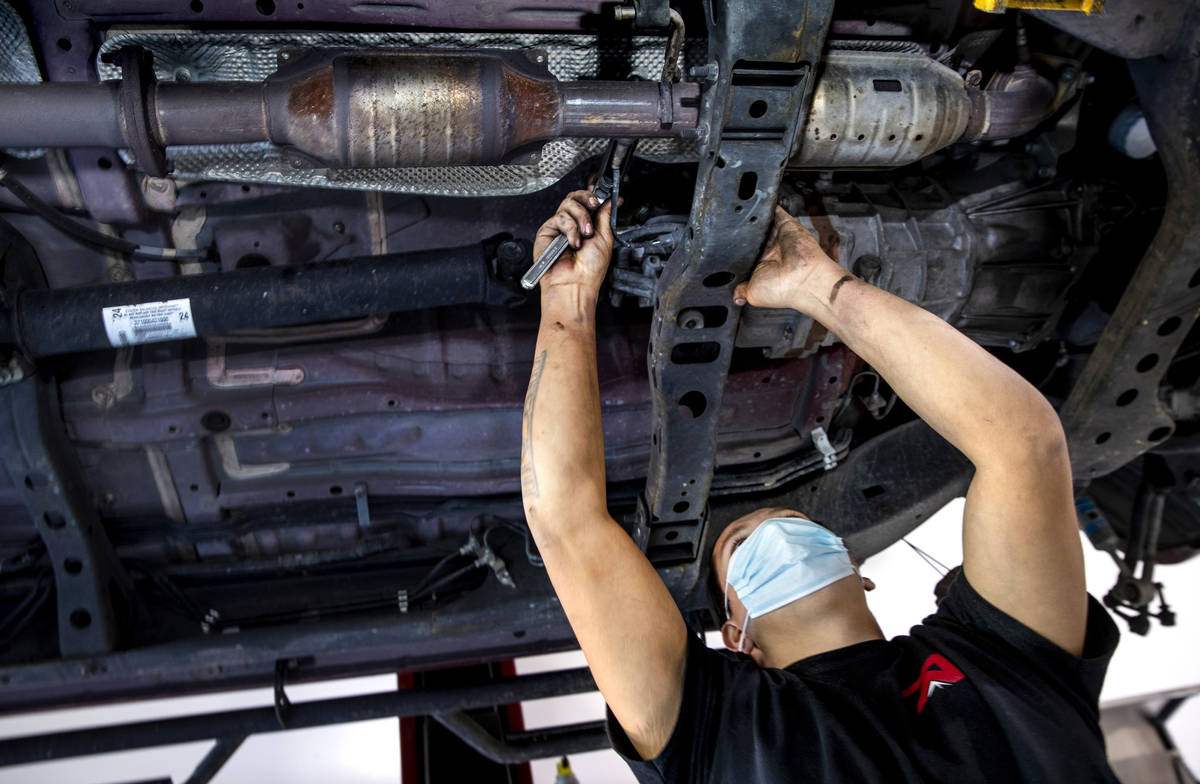 Mechanic Johnny Mejia with Red Rock Repair works beneath a car on Nov. 24, 2020. The shop's own ...