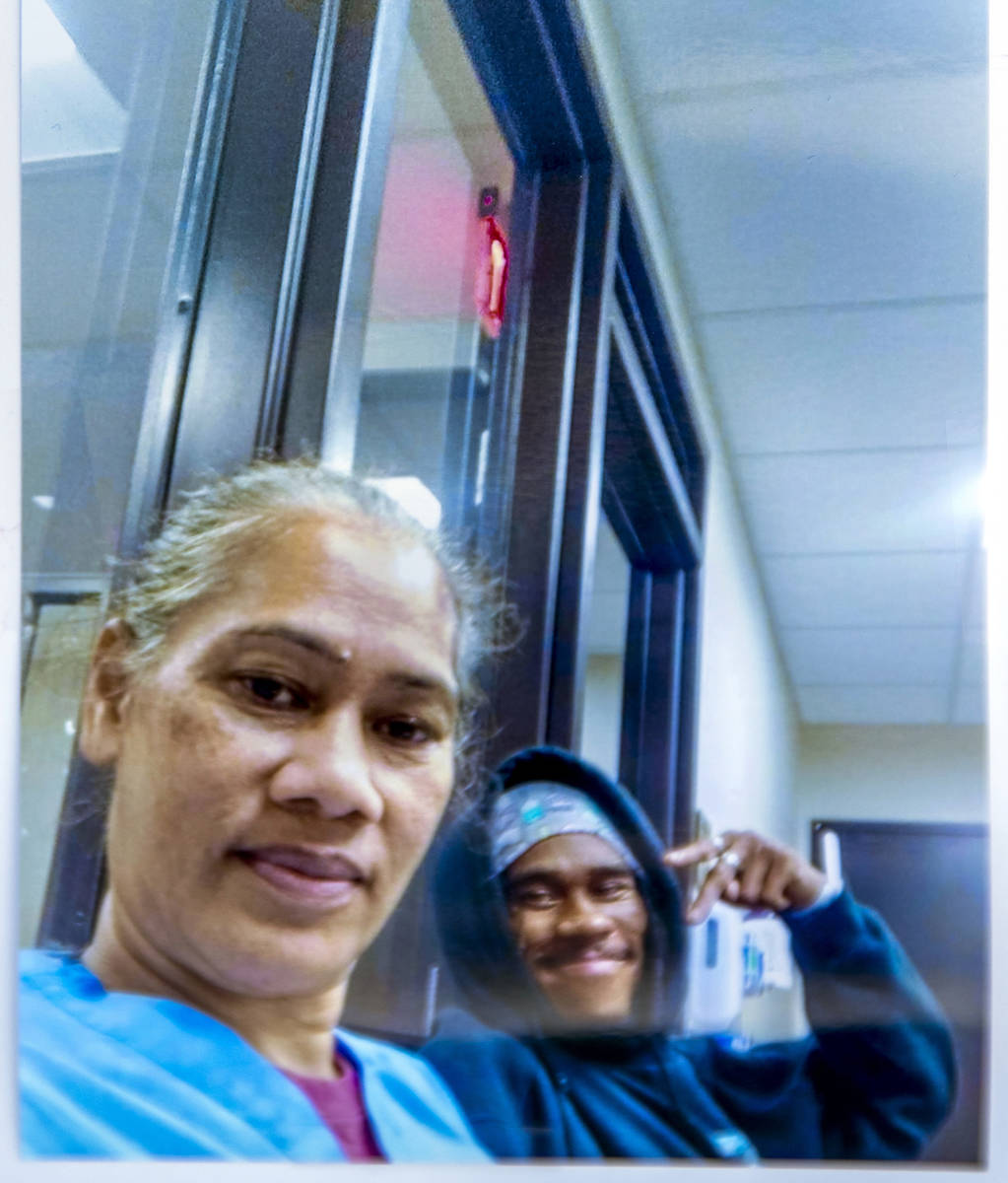 This undated photo shows Evelini Gibbs, left, with her son Genesis Atkins, a motorcyclist who w ...