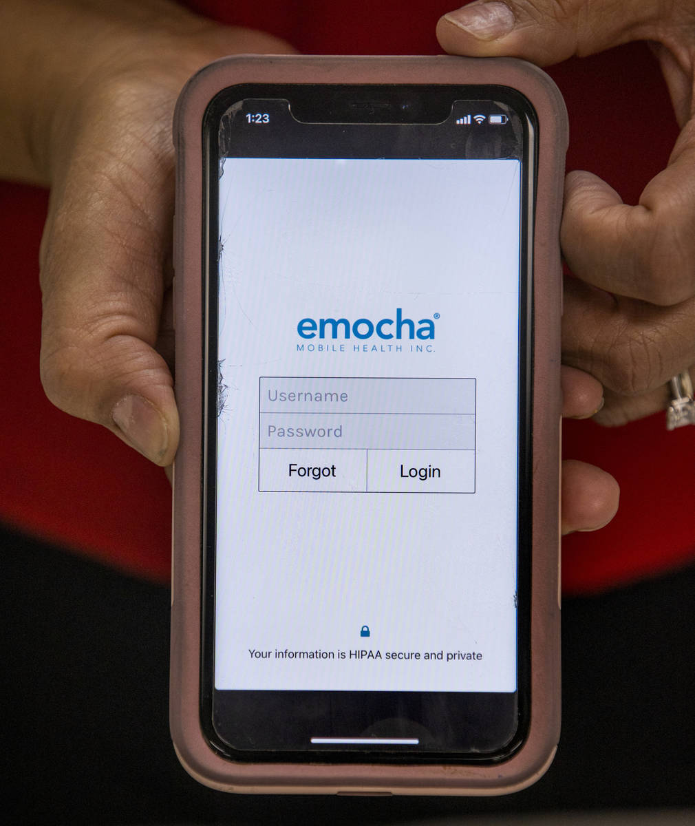 Clark County Education Association President Marie Neisess with the emocha app on her phone whi ...