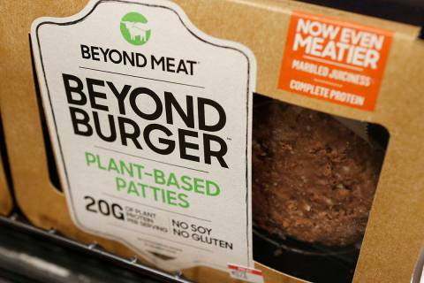 In a June 27, 2019, file photo a meatless burger patty called Beyond Burger made by Beyond Meat ...