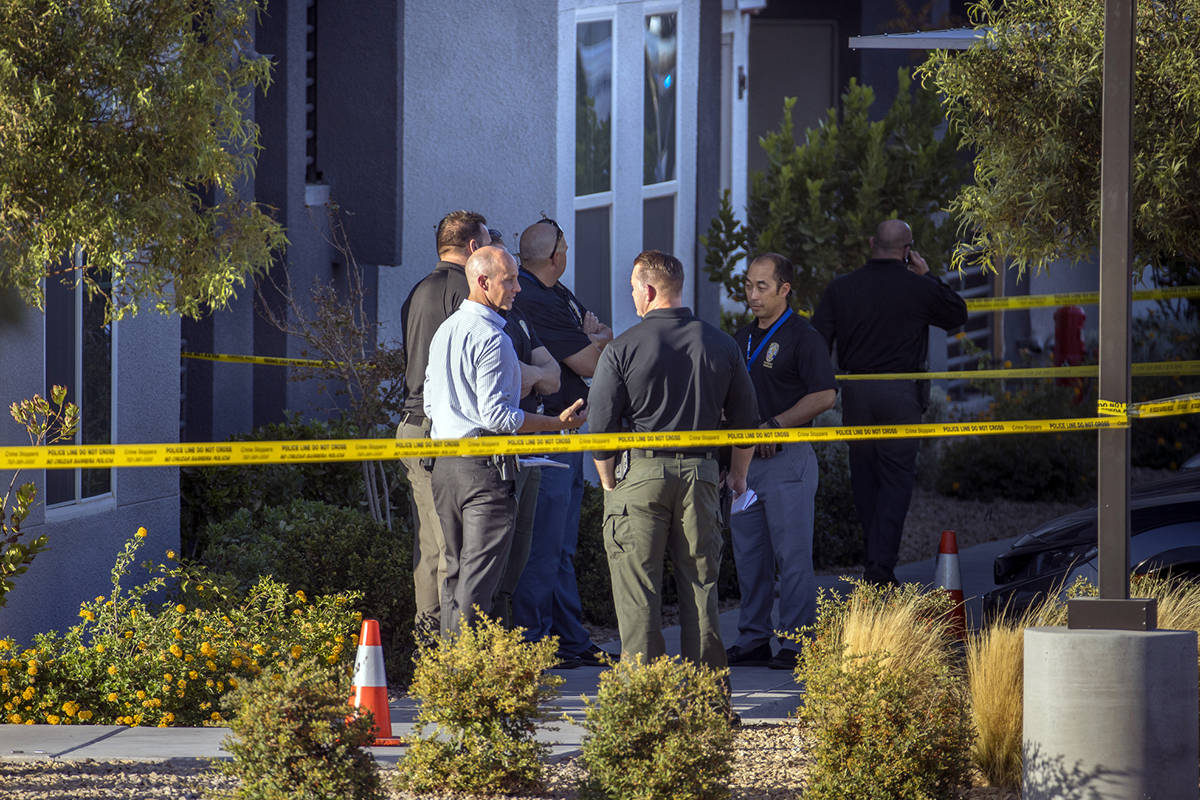 Officials gather outside after four were killed and one injured in police shooting at The Dougl ...