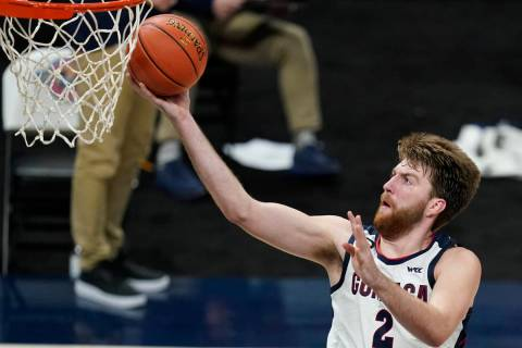 Gonzaga's Drew Timme goes to the basket during the second half of the team's NCAA college baske ...