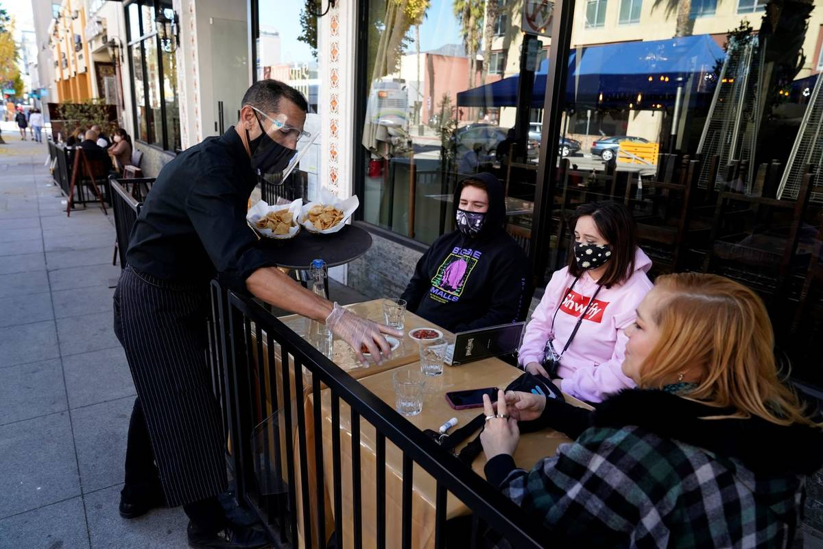Customers are served lunch at an outdoor seating space Tuesday, Dec. 1, 2020, in Pasadena, Cali ...