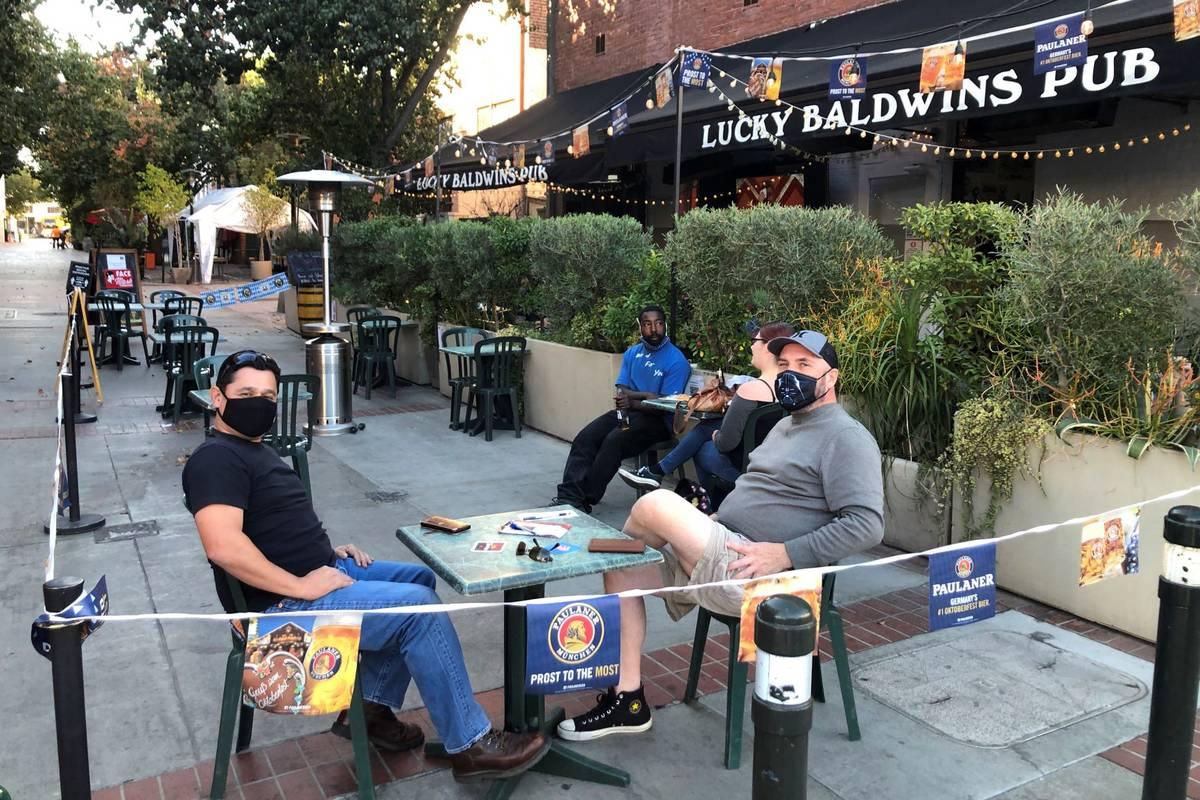 Anthony Angulo, left, and Jeff Koloski sit on the patio of Lucky Baldwin's pub on Monday, Nov. ...