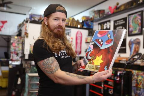 Caleb Cashew, owner of Black Omen Tattoo, is raffling off his business and inventory to one luc ...