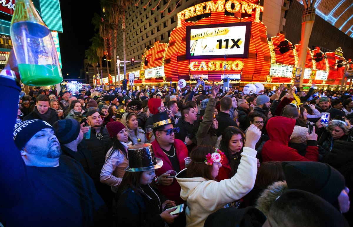 New Year's Eve revelers gather at a stage at the Fremont Street Experience in downtown Las Vega ...