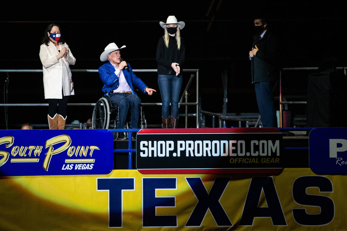 Texas Gov. Greg Abbott (center) and first lady Cecilia Abbott (left) welcome visitors to the op ...