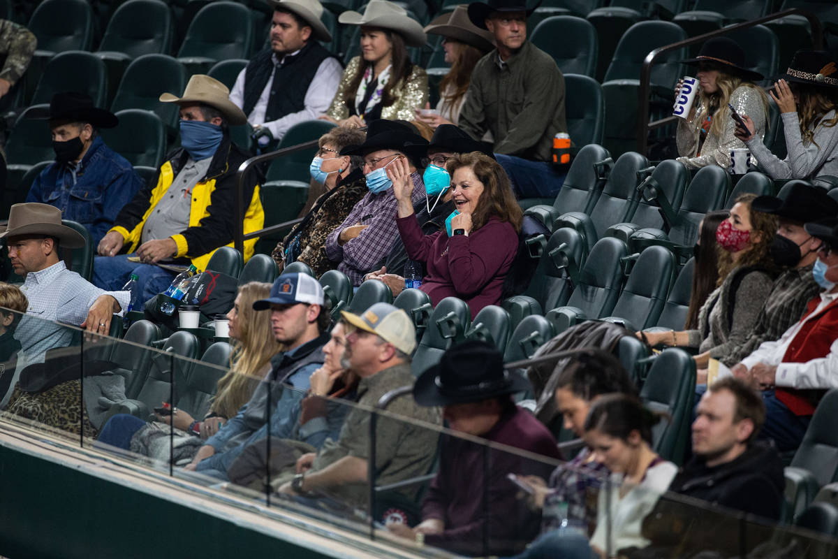 Crowd members watch PRCA contestants compete during the opening night of the National Finals Ro ...