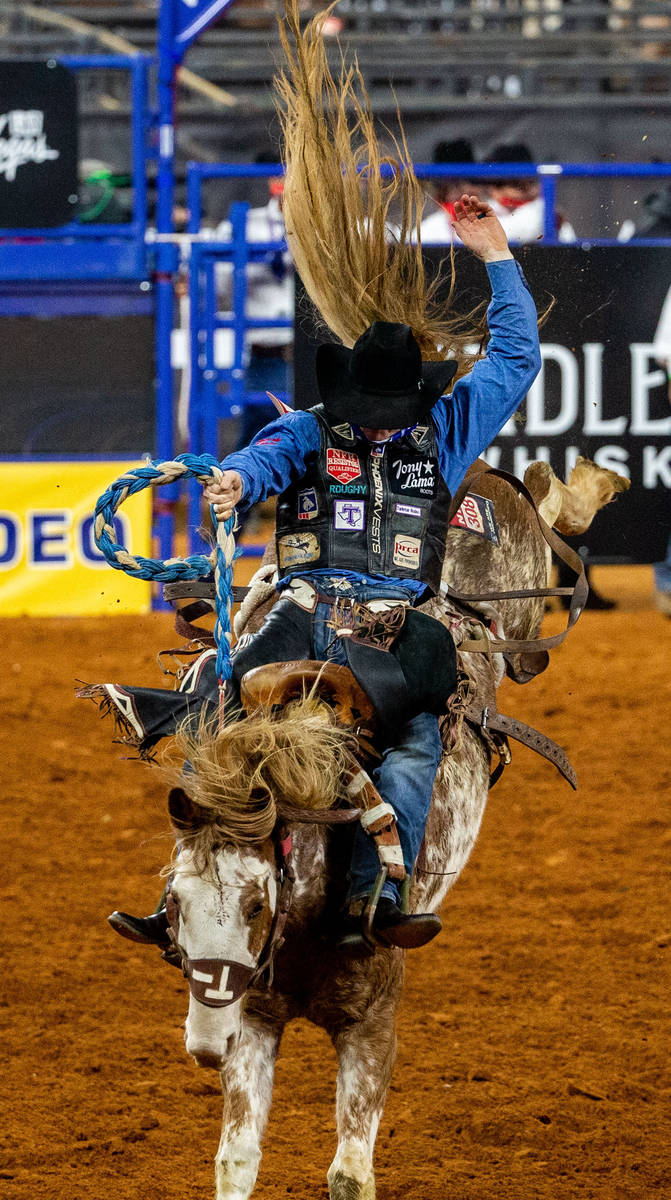 PRCA Saddle Bronc contestant Rusty Wright wins the first round of his event with a score of 86 ...