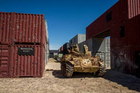 "An armored vehicle riddled with bullet holes waits in ""Damnation Alley,"" where aircraft and gro ..."